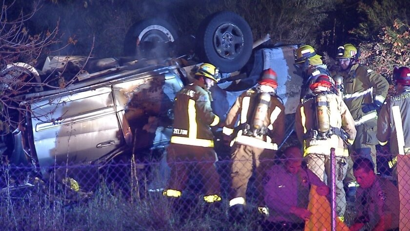 A pickup caught fire after veering off the freeway and slamming into a raised curb in El Cajon. The driver was killed.
