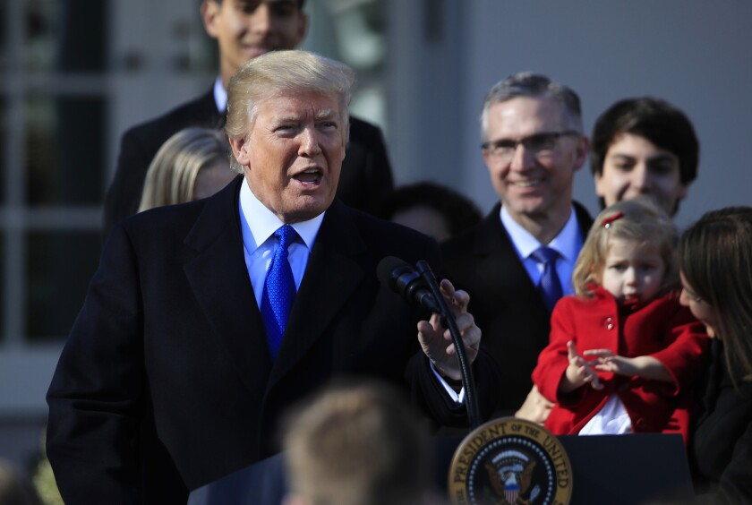 In this Jan. 19, 2018, photo, President Donald Trump speaks to participants of the March for Life event, in the Rose Garden of the White House. The Trump administration will resurrect a Reagan-era rule that would ban federally-funded family planning clinics from discussing abortion with women, or sharing space with abortion providers.