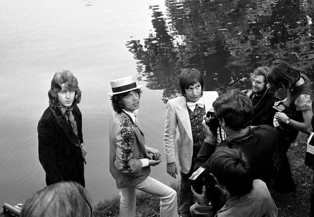 Mick Taylor, Mick Jagger and Charlie Watts hold a press conference at the Bois de Boulogne in Paris in 1972.