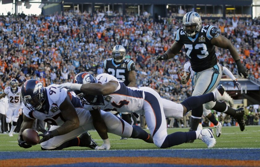 Denver Broncos' Malik Jackson (97) scores a touchdown during the first half of the NFL Super Bowl 50 football game Sunday, Feb. 7, 2016, in Santa Clara, Calif. (AP Photo/Julie Jacobson)