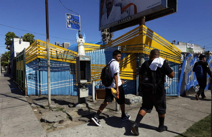 Students walking home from school pass the corner of East 109th Street and Wilmington Ave. in Watts on Aug. 4.