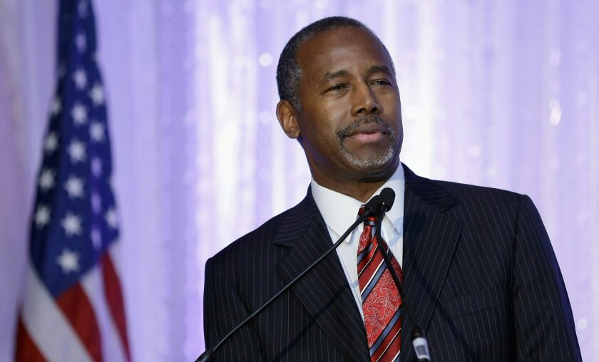 FILE - In this Nov. 6, 2015 file photo, Republican presidential candidate Ben Carson speaks during the Black Republican Caucus of South Florida event benefiting the group's scholarship fund, in Palm Beach Gardens, Fla. Carson has held hardly any campaign events in the past month, spending much of h