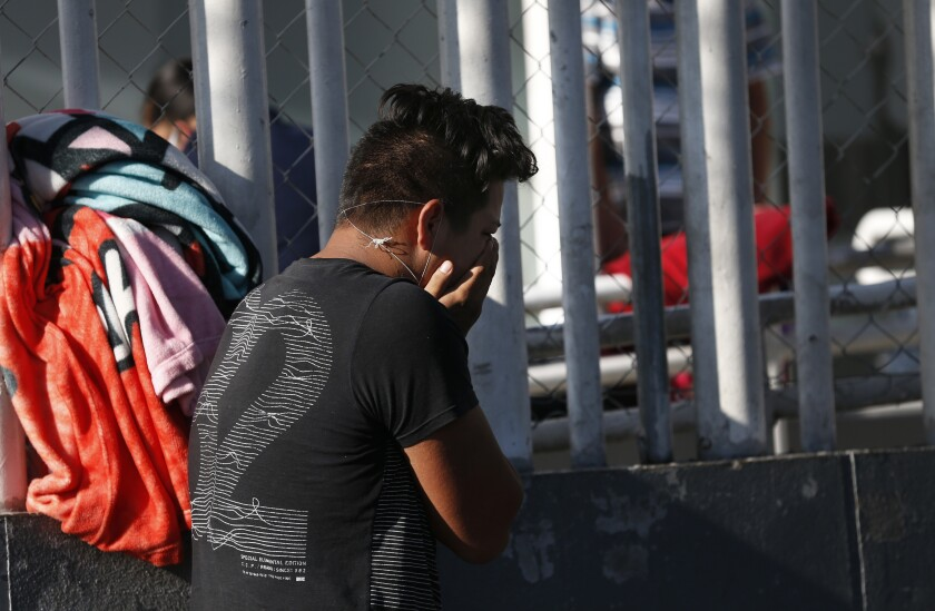 Brando Gonzalez Ortiz cries after receiving the news of his mother Carmen Ortiz's death of COVID-19 outside Iztapalapa General Hospital in Mexico City on May 3, 2020.