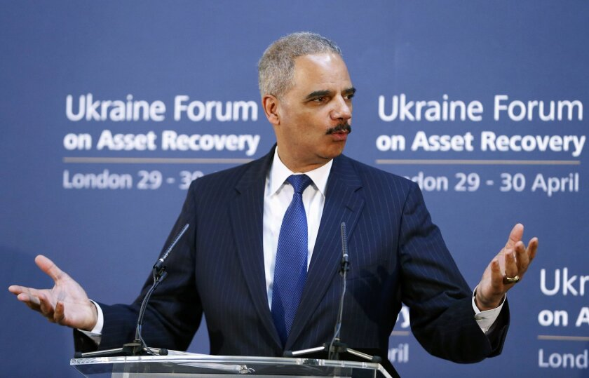 """U.S. Attorney General Eric Holder speaks at the Ukraine Forum on Asset Recovery in central London, Tuesday April 29, 2014. Britain and the United States are co-hosting the two-day """"asset recovery forum"""" designed to help find and recover assets believed to have been stolen by the regime of ousted Ukrainian president Viktor Yanukovych. (AP Photo/Andrew Winning, Pool)"""