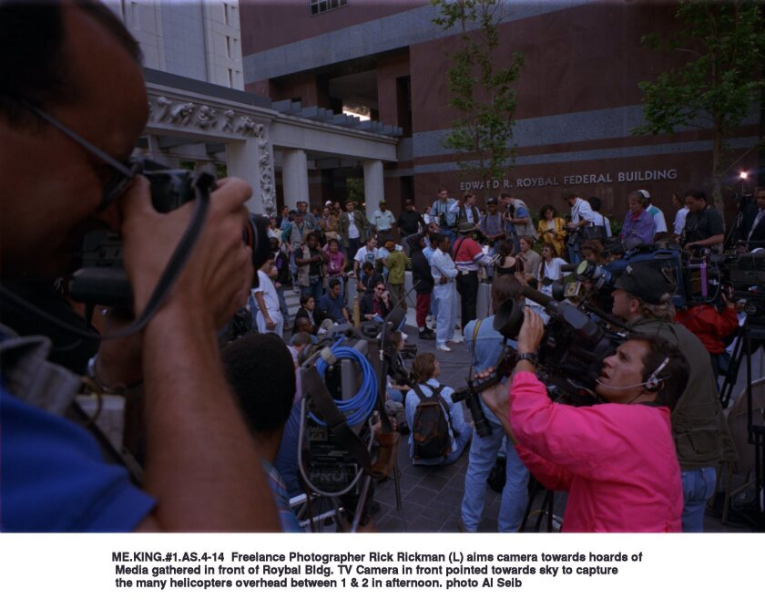 Media and members of the public gather in front of the Roybal Federal Building, where four police officers were being tried in the beating of Rodney King in 1993.