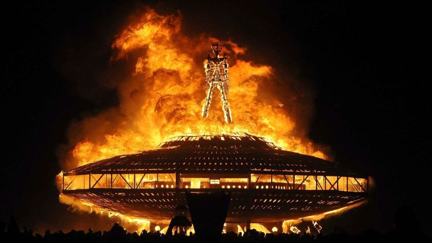 "FILE - In this Aug. 31, 2013 file photo, the ""Man"" burns on the Black Rock Desert at Burning Man nea"