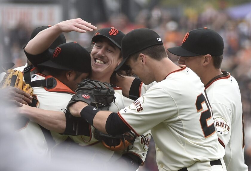 Tim Lincecum, center, is mobbed by Giants teammates after no-hitting the Padres in 2014.