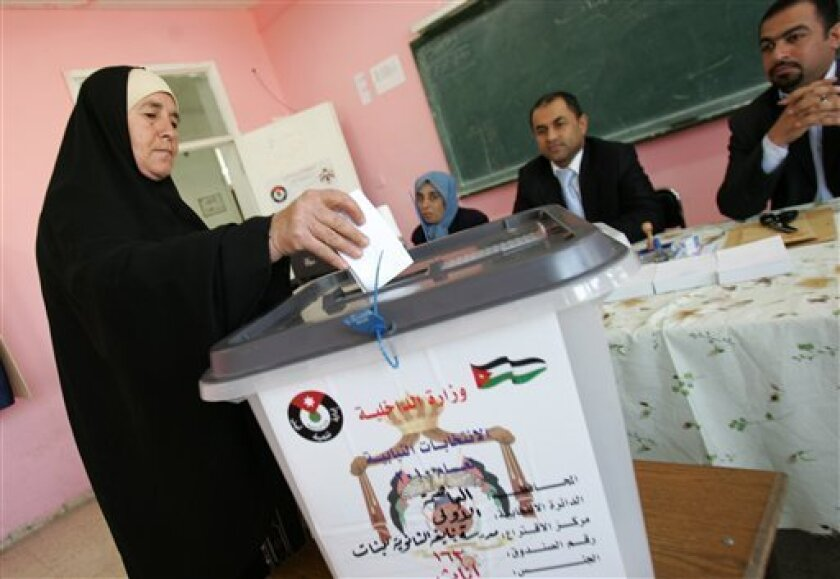A Jordanian woman casts her vote in a polling station in Amman, Jordan, Tuesday, Nov. 9 2010. Jordanians began voting Tuesday for their fourth parliament under reformist King Abdullah II, but many were skeptical that the new legislature will be able to create needed jobs or alleviate growing poverty. (AP Photo/Nader Daoud)