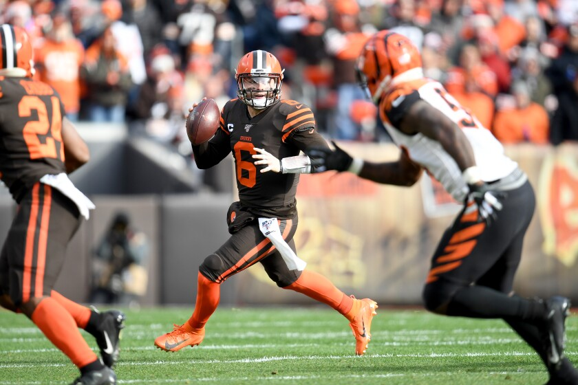 Cleveland Browns quarterback Baker Mayfield looks to pass against the Cincinnati Bengals on Sunday.