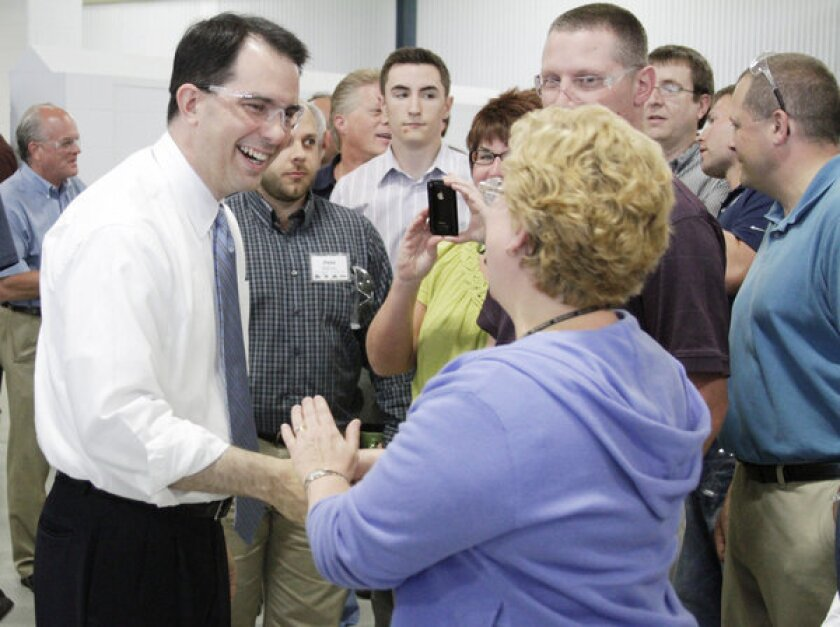 Wisconsin Gov. Scott Walker, who faces a recall election next week, greets Husco International workers in Waukesha.