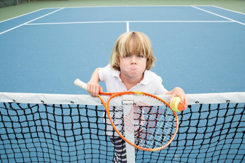 Barnaby Pearce, 6, is enrolled in the youth beginner tennis program at La Jolla YMCA. Some members, including Barnaby's mother, Victoria Pearce, who also plays tennis there, are not happy the facility's tennis courts will be removed in August. Photo by Victoria Pearce
