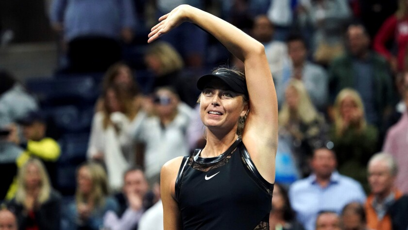 Maria Sharapova waves to the crowd after defeating Sofia Kenin during their third-round match at the U.S. Open on Friday night.