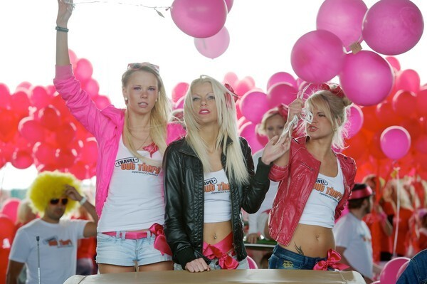 Blondes in pink wigs parade along the river Daugava in Latvia's capital Riga.
