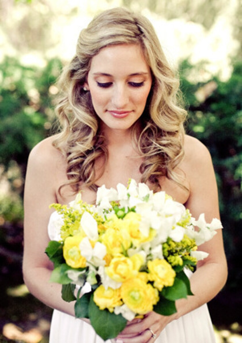 Erica Beukelman, owner of 10.11 Makeup, used neutral, fresh hues on this bride, along with lush lashes and a pretty pink pout.
