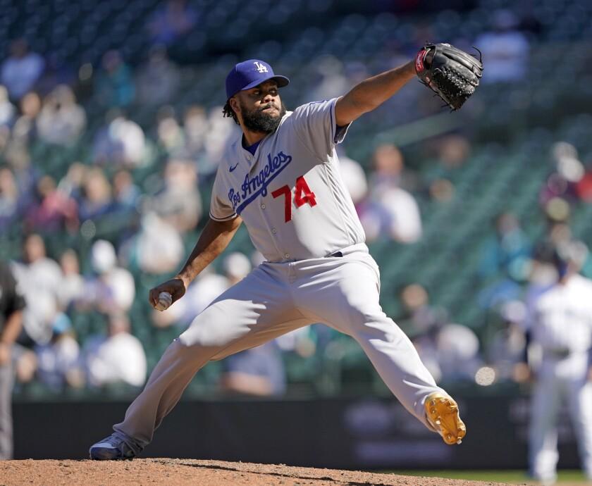 Kenley Jansen throws a baseball