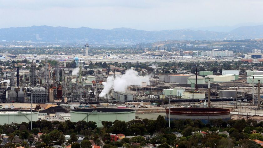 FILE - This May 25, 2017 aerial photo shows the Standard Oil Refinery in El Segundo, Calif., with Lo