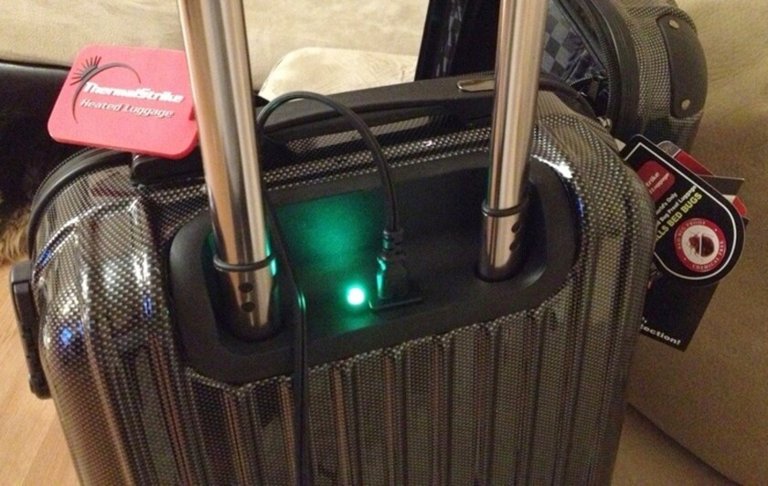 The green light shows that the ThermalStrike bag is heating, working to kill bugs.