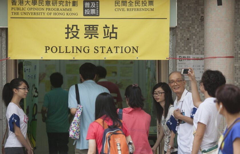 Hong Kong residents vote in a nonbinding referendum on universal suffrage at a polling station in the New Territories region of Hong Kong on June 22.