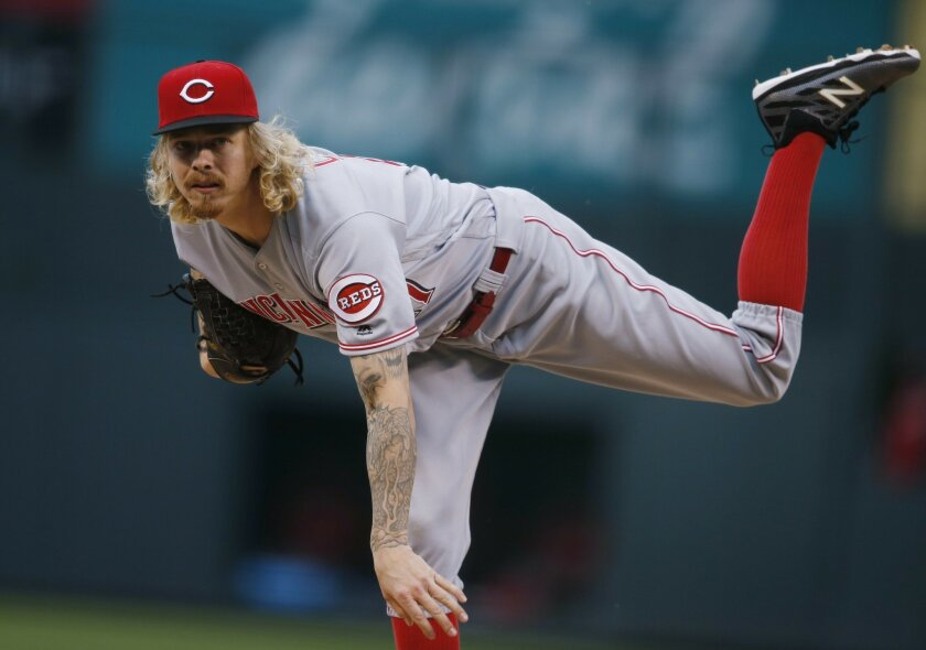Cincinnati Reds starting pitcher John Lamb delivers a pitch to Colorado Rockies' Carlos Gonzalez in the first inning of a baseball game Wednesday, June 1, 2016, in Denver. (AP Photo/David Zalubowski)