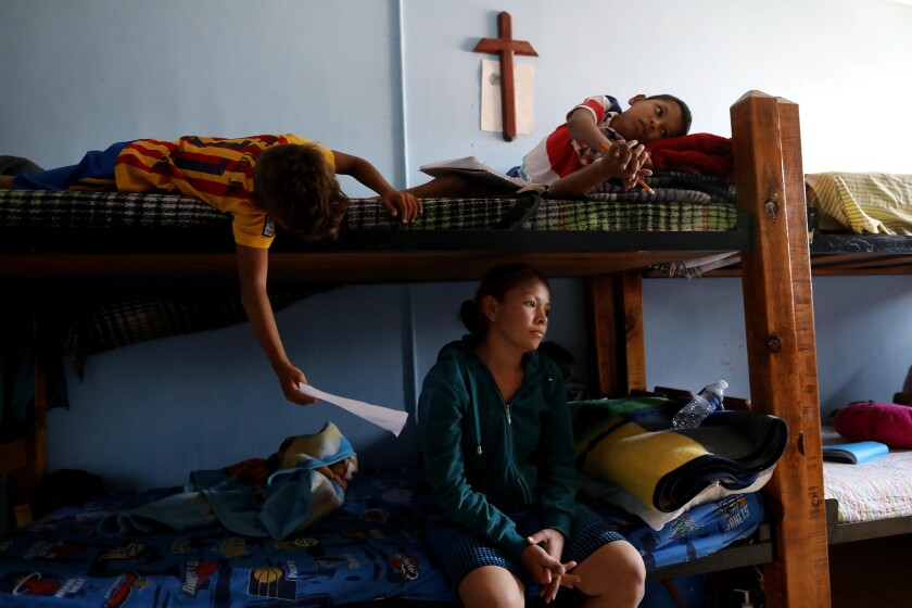 Merlin Genoveva Avila Amador, 27, of Tegucigalpa, Honduras, with children Leonel Moya Avila, 8, left, and Jonathan Moya Avila, 11, at a shelter in Ciudad Juarez, Mexico.