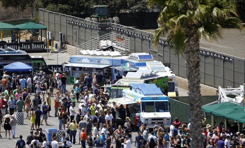 At the gourmet food truck and craft beer festival held behind the grandstand area on the southwest end of the track, those who were willing were exposed to all kinds of culinary treats.