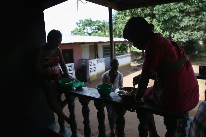 Family members of Marthalene Williams, the woman who most likely infected Eric Duncan, the first Ebola patient to develop symptoms in the United States, eat lunch at the home in Liberia where she died.