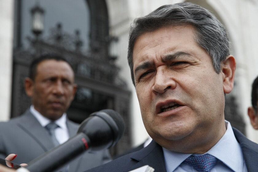 FILE - In this Aug. 13, 2019 file photo, Honduran President Juan Orlando Hernandez answers questions from the Associated Press, as he leaves a meeting at the Organization of American States, in Washington. U.S. prosecutors said on Tuesday, March 3, 2020, that Hernandez met with an Honduran drug dealer in 2013 and agreed to facilitate the use of Honduran armed forces personnel as security for the dealer's drug trafficking activities. In 2013, Hernandez was a congressman. He was elected president at the end of that year. (AP Photo/Jacquelyn Martin, File)