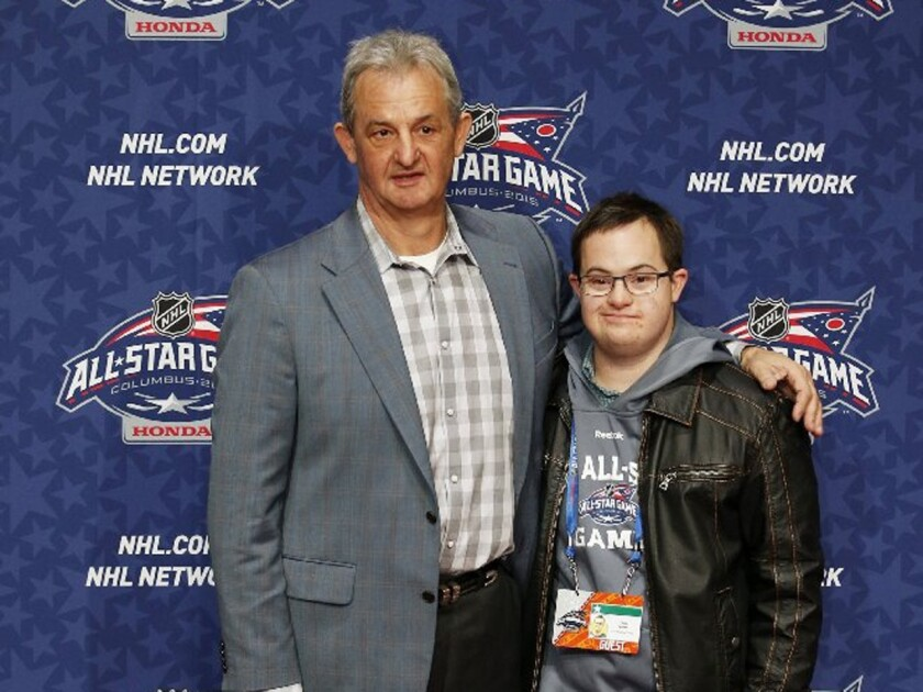 Team Foligno Coach Darryl Sutter of the Kings and his son, Chris Sutter, pose on the NHL All-Star Weekend red carpet in Columbus, Ohio.