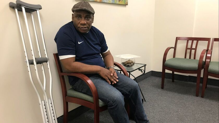 Gbolahan Banjo, 48, of Nigeria, waits to speak to an immigration lawyer in Montreal to discuss his c