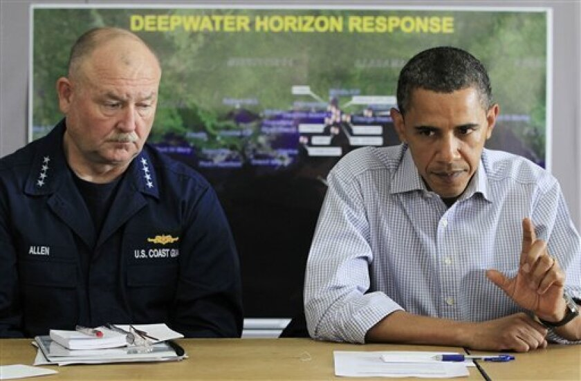 FILE - In this June 4, 2010 file photo, President Barack Obama, accompanied by by National Incident Commander Adm. Thad Allen, makes a statement after being briefed on the BP oil spill relief efforts in the Gulf Coast region, at Louis Armstrong International New Orleans Airport in Kenner, La. (AP Photo/Charles Dharapak, file)