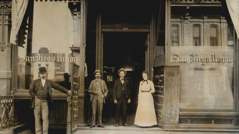 Outside The Union's home on Fourth Avenue between Broadway and E Street, circa 1897. The man at far left is unknown; the others, from left: Edmund F. Parmelee, business and advertising manager; Herbert B. Hakes, cashier; and Josephine Price, bookkeeper.