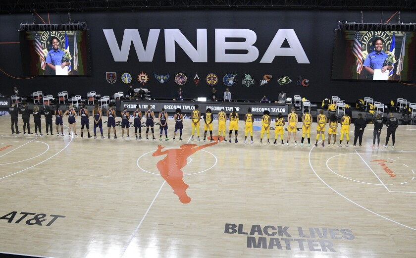 Members of the Phoenix Mercury, left, and Sparks stand for a moment of silence in honor of Breonna Taylor.