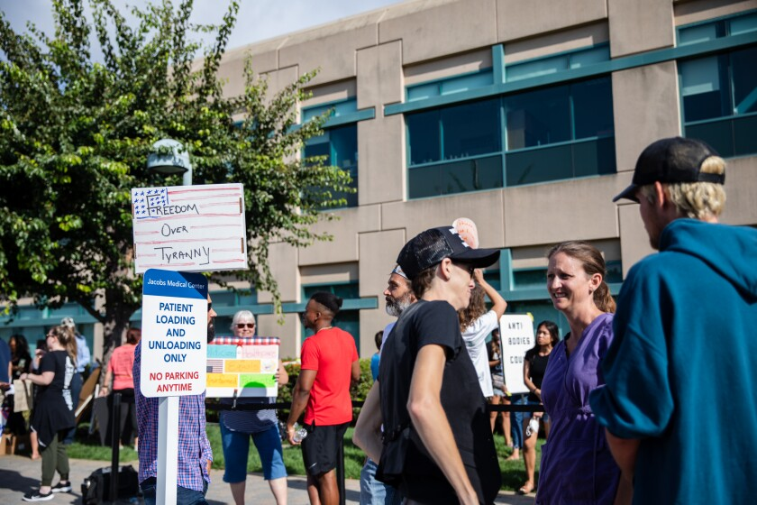 Demonstrators protest against vaccines outside Jacobs Medical Center at UC San Diego Health on Wednesday.