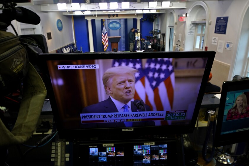 President Trump is seen on a network monitor after his prerecorded farewell speech was released.