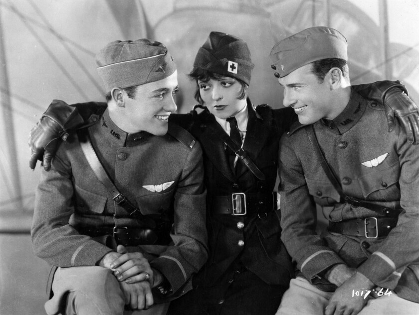 """Buddy Rogers, left, Clara Bow, and Richard Arlen in """"Wings."""""""