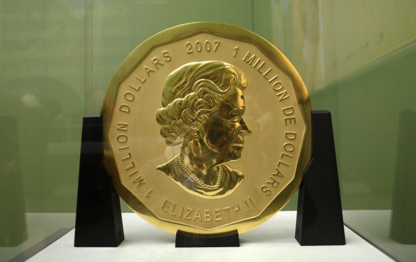 FILE -- In this Dec. 8, 2010 photo a 100-kilogram (221-pound) Canadian gold coin is displayed at the Bode Museum in Berlin, Germany. Berlin police raided a series of homes and jewelry shops on suspicion they could be connected to the gold coin that was stolen from a museum in the German capital in 2017. (Marcel Mettelsiefen/dpa via AP, file)