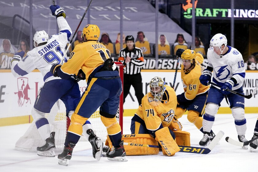Tampa Bay Lightning center Steven Stamkos scores a goal against Nashville Predators goaltender Juuse Saros.