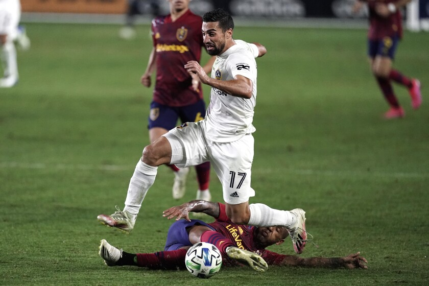 Galaxy midfielder Sebastian Lletget, top, avoids a tackle from Real Salt Lake's Everton Luiz.