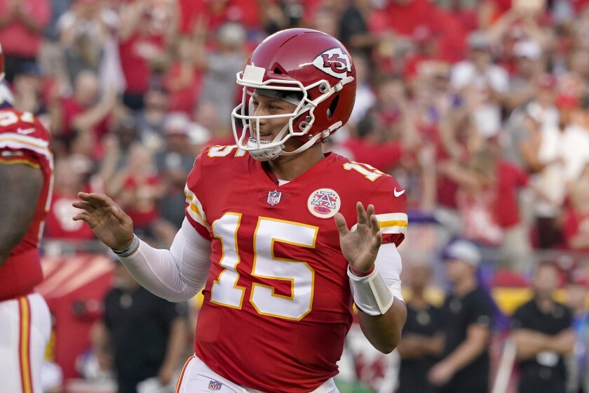 Kansas City Chiefs quarterback Patrick Mahomes celebrates after throwing a touchdown pass during the first half of an NFL football game against the Minnesota Vikings Friday, Aug. 27, 2021, in Kansas City, Mo. (AP Photo/Ed Zurga)