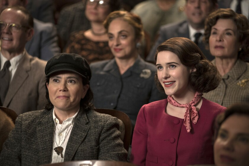 """This image released by Amazon shows Alex Borstein as Susie Myerson, left, and Rachel Brosnahan as Midge Maisel in """"The Marvelous Mrs. Maisel."""" (Nicole Rivelli/Amazon via AP)"""