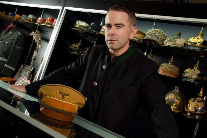 Solana Beach historical artifacts dealer Craig Gottlieb holds Adolf Hitler's uniform hat, one of several personal items owned by the German dictator that he recently acquired and is now selling. CREDIT: Jared Nelson