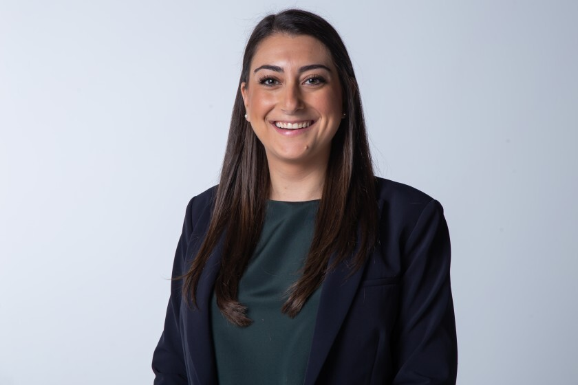 Congressional candidate Sara Jacobs poses for a portrait in December 2019 .