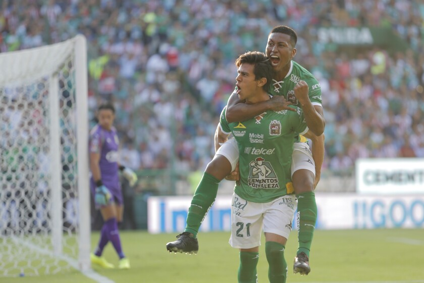 LEON, MEXICO - AUGUST 17: Jose Juan Macias #21 of Leon, celebrates with teammates after scoring the first goal of his team during the 5th round match between Leon and Chivas as part of the Torneo Apertura 2019 Liga MX at Leon Stadium on August 17, 2019 in Leon, Mexico. (Photo by Leopoldo Smith/Getty Images) ** OUTS - ELSENT, FPG, CM - OUTS * NM, PH, VA if sourced by CT, LA or MoD **