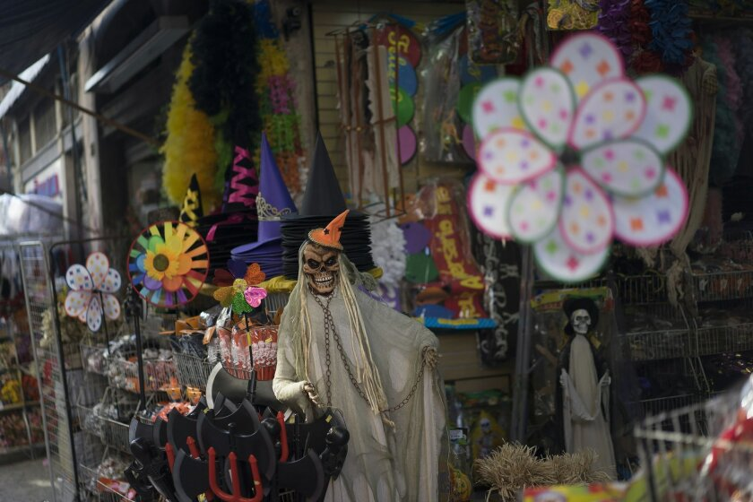 "In this Sept. 18, 2015 photo, Halloween products are displayed in the entrance of a store at the Saara street market in Rio de Janeiro, Brazil. For visitors capable of prying themselves off Copacabana's golden sands, the neighborhood, known in Portuguese as ""Centro"" is a fascinating detour. (AP Photo/Leo Correa)"