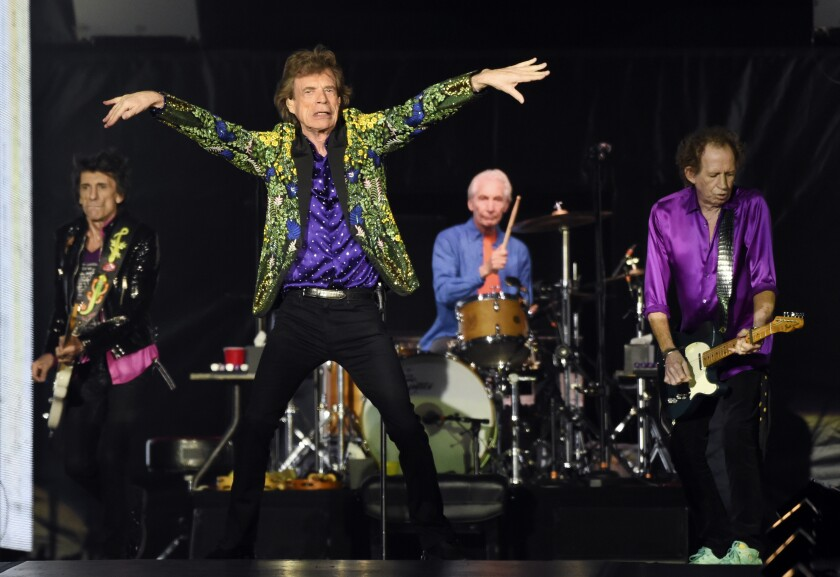 """FILE - Ron Wood, from left, Mick Jagger, Charlie Watts and Keith Richards of the Rolling Stones perform during their concert in Pasadena, Calif. The Rolling Stones are releasing a new version of their 1973 album """"Goats Head Soup"""" with three unheard tracks. One of the new tracks is called """"Scarlet"""" and features Led Zeppelin guitarist Jimmy Page. The album coming out on Sept. 4, 2020 will have a four-disc CD and vinyl box set edition with ten bonus tracks. The Stones also released a video for one of the unheard songs, called """"Criss Cross."""" (Photo by Chris Pizzello/Invision/AP, File)"""