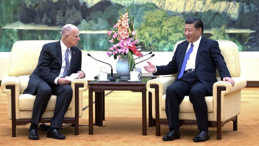 President Xi Jinping, right, meets with California Gov. Jerry Brown at the Great Hall of the People in Beijing to talk about climate change and the U.S. pullout of the Paris climate accords.