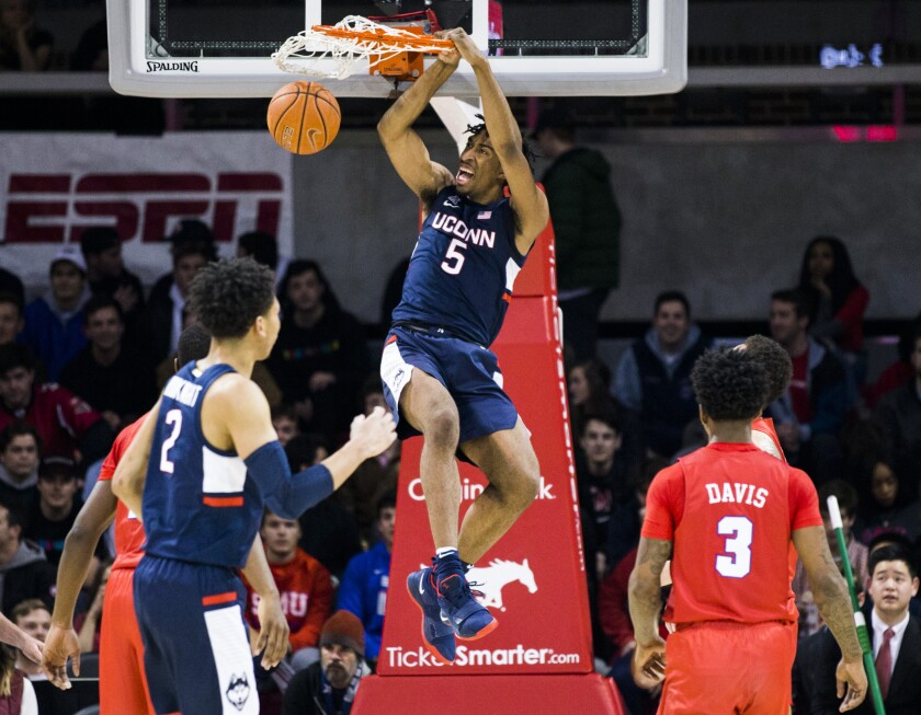 Connecticut forward Isaiah Whaley (5) dunks the ball during the first half of an NCAA college basketball game against Connecticut Wednesday, Feb. 12, 2020, in Dallas. (Ashley Landis/The Dallas Morning News via AP)