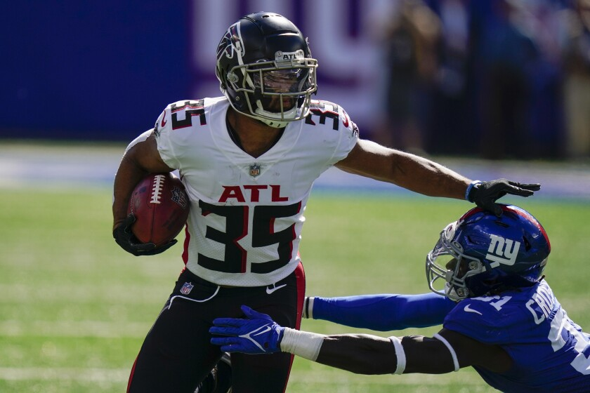 Atlanta Falcons cornerback Avery Williams (35) runs the ball against New York Giants defensive back Keion Crossen (31) during the first half of an NFL football game, Sunday, Sept. 26, 2021, in East Rutherford, N.J. (AP Photo/Seth Wenig)