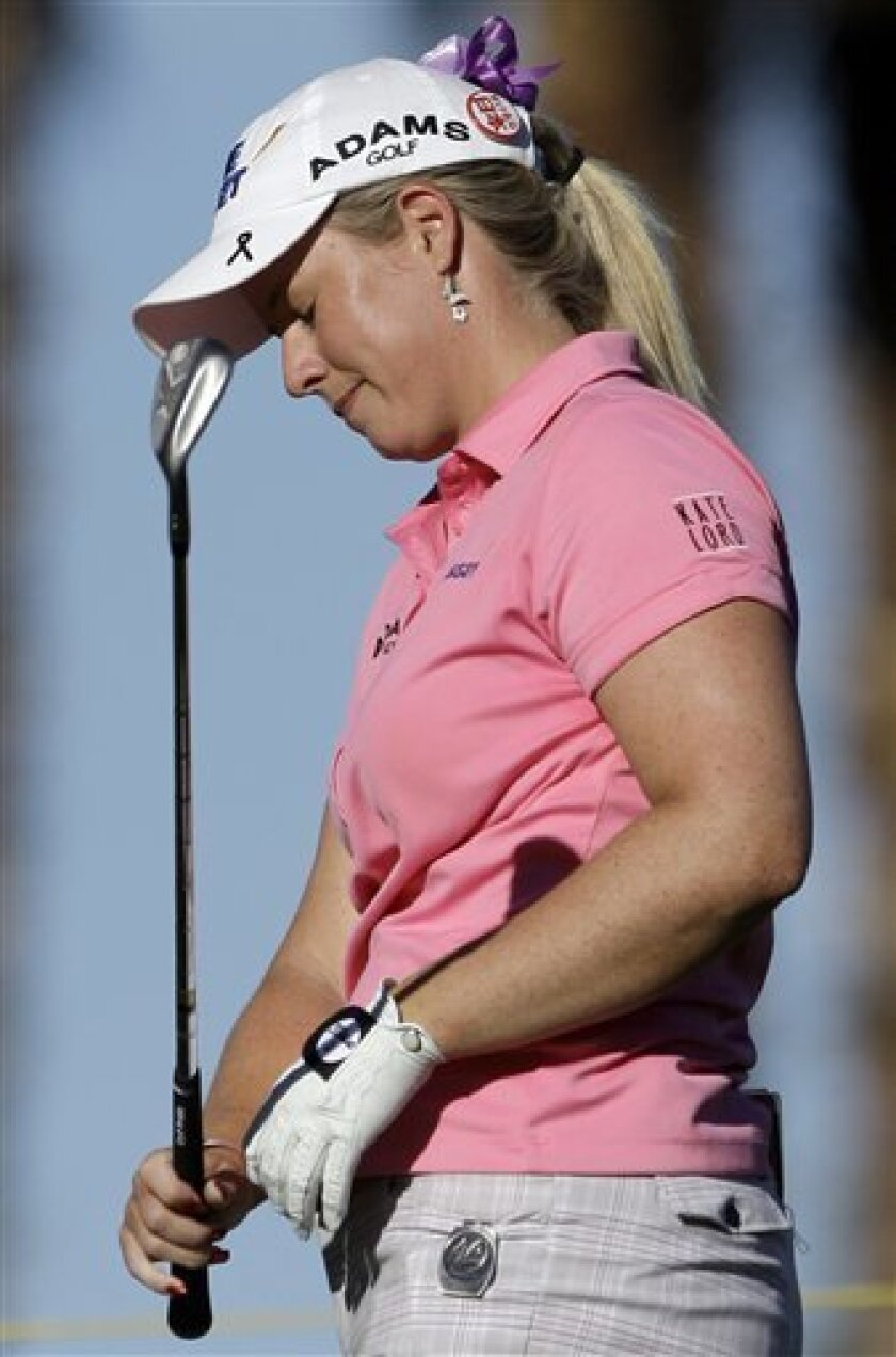 Brittany Lincicome reacts to her putt on the eighth green in the first round of the LPGA Kraft Nabisco championship golf tournament at Mission Hills Country Club in Rancho Mirage, Calif., Thursday, March 31, 2011. (AP Photo/Reed Saxon)