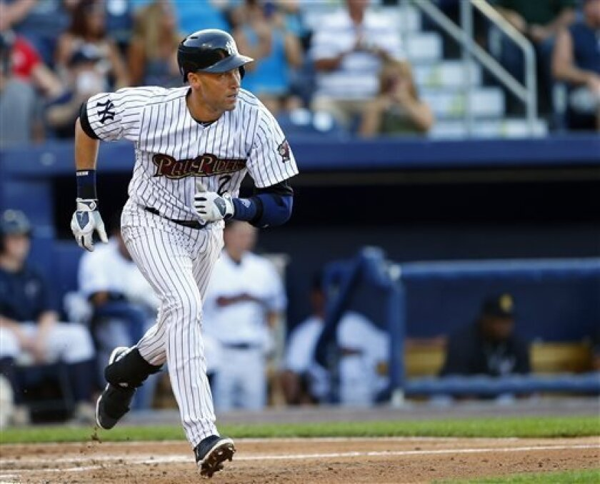 New York Yankees shortstop Derek Jeter runs to first as he lines out to second base during the third inning of a minor league baseball rehab start with the Scranton/Wilkes-Barre RailRiders in a game against the Lehigh Valley Iron Pigs, Saturday, July 6, 2013, in Moosic, Pa. (AP Photo/Rich Schultz)